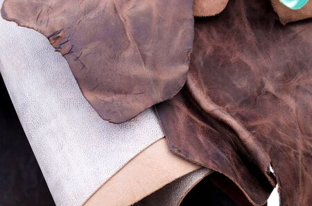 Close up view on colorful hanging and folded fabric textures and textiles in high resolution found on a fabrics market