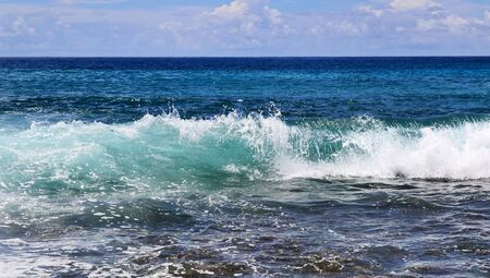 Beautiful splashing turquoise ocean waves at the white beaches on the paradise island Seychelles