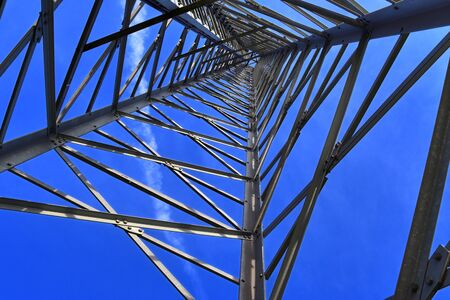 Close up view on a big power pylon transporting electricity in a countryside area