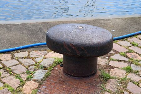 Aged and weathered bollard at the baltic sea port of Kiel in Germany