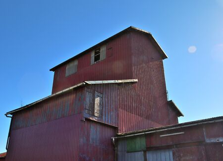 Detailed view on an aged and abandoned Farmhouse on a sunny day Imagens