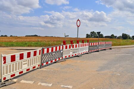Blocked road at a construction site on a northern european road on a sunny day