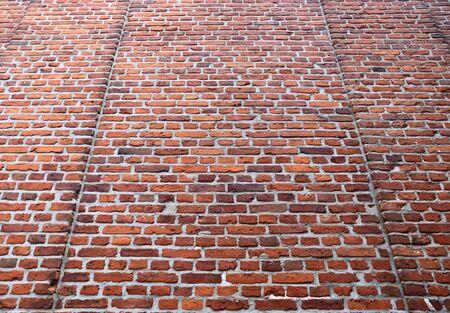 Alte Backsteinmauer. Textur des alten verwitterten Backsteinmauer-Panoramahintergrundes. Standard-Bild