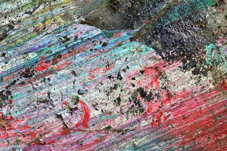 Colorful graffiti paint splashes on the wall and ground at a lost place ruin in Kiel northern germany