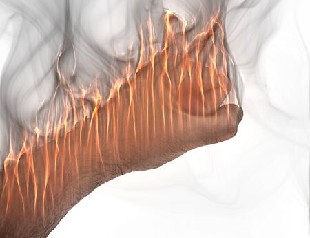 A human hand on fire burning with orange flames and some smoke in front of a white background Stok Fotoğraf