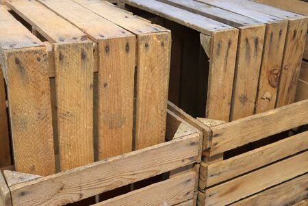 Very old wooden crates with some cracks in a close view