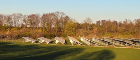 Generating clean energy with solar modules in a big park in northern Europe. Banque d'images