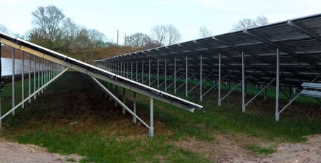 Generating clean energy with solar modules in a big park in northern Europe. Banco de Imagens