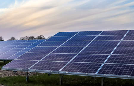 Generating clean energy with solar modules in a big park in northern Europe. Stock fotó