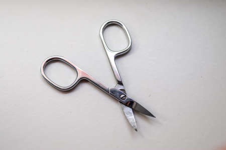 Manicure scissors closeup on white background Stock fotó