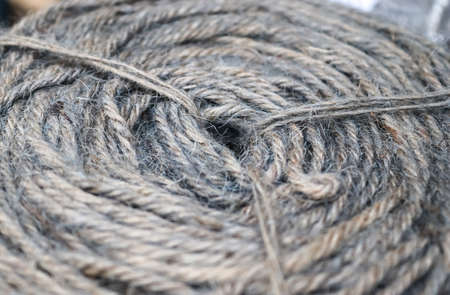Stranded threads. A tangle of yarn. Entangled confusing thread on a roll
