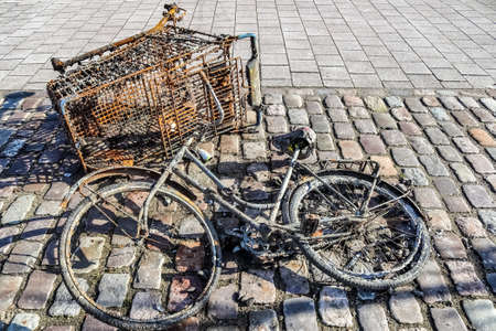 Rusty bicycle got out water from cleaning the port of Kiel in Germany