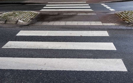 White painted pedestrian zebra crossing on a road in Europe