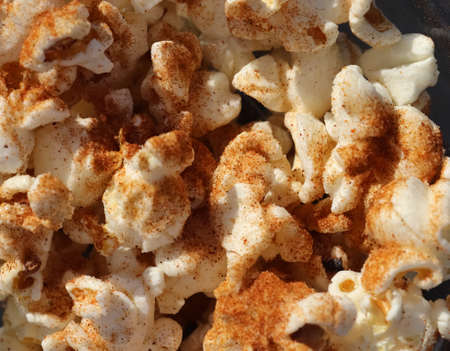 Close up on spiced popcorn in a glas bowl