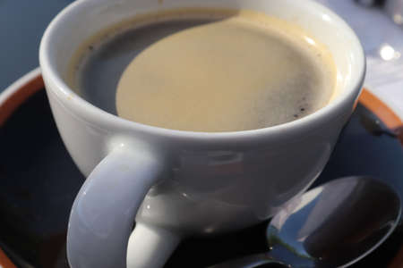 Close up view at a coffee surface in a cup.
