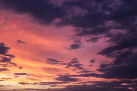 Beautiful panorama of orange and yellow clouds at sunset in the sky Standard-Bild