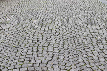Close up view on old historical cobblestone roads and walkways all over europe Standard-Bild