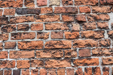 Old red rick wall. Texture of old weathered brick wall panoramic background.