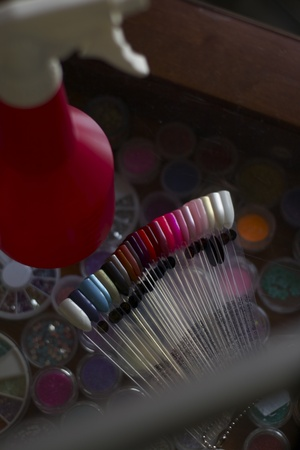 Artificial nail palette and water spray bottle at beauty salon photo