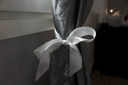 Fabric bowtie around curtain Stock Photo