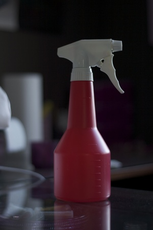 Water spray bottle at beauty salon glass table photo