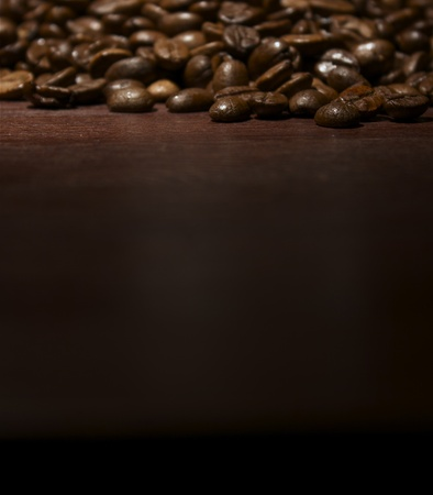 Coffee beans at wooden table