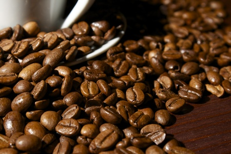 Coffee beans at wooden table closeup
