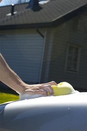 Handwashing cars hood on a sunny day  photo