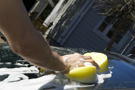 Man washing dirty car with a sponge  photo