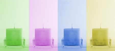 Four colorful candles in a line