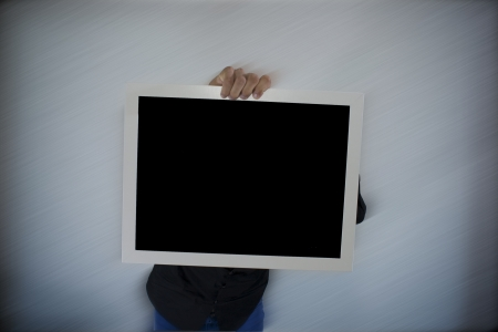 Man holding an empty sign Stock Photo - 13854192