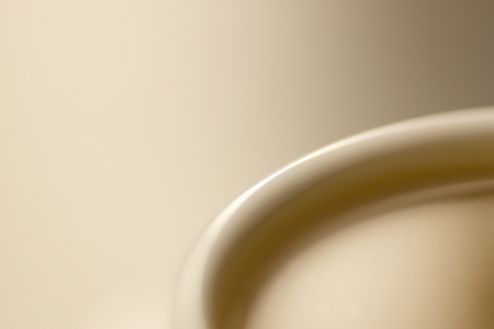 igrave: Tasteful light brown coffee closeup Stock Photo