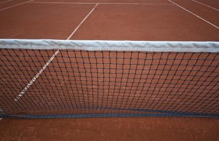 tennis clay: Tennis net explains business barrier   Stock Photo