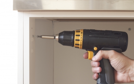 Construction concept with screwdriver and screw closup Stock Photo - 14414846