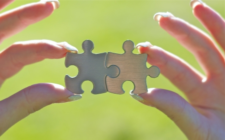 Woman holding two puzzle pieces in hands. Good for business concept. Stock Photo - 14414766