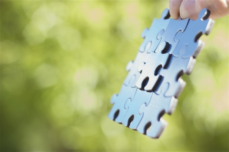 Business concept with nine stainless steel puzzle pieces. photo