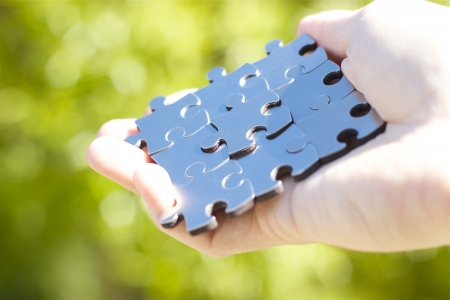 Handing nine puzzle pieces for business concept Stock Photo - 14414863