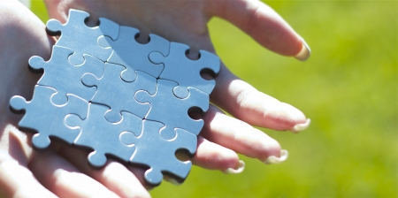 Hands giving nine puzzle pieces for business concept Stock Photo - 14414854