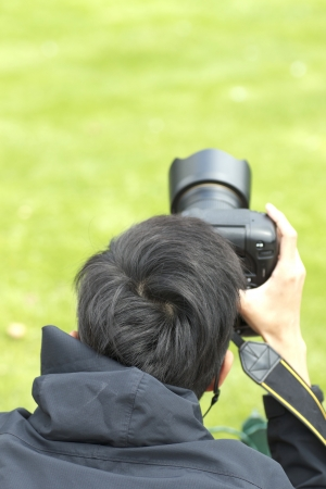 Wedding photographer taking his shots at work  Stock Photo - 14660959