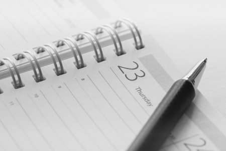 Calendar and pen closeup photi in an office desk  Stock Photo - 15183294