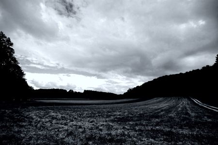 west of germany: A typical field landscape scene of south west Germany, black & white shot with dramatic exposure Stock Photo