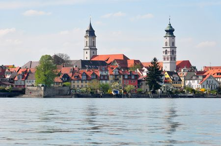 near side: View of Lindau (Island of Lindau) at the east side of Lake Constance,  Famous touristic attraction located in Bavaria, Germany, directly near the Swiss and Austrian border. Stock Photo