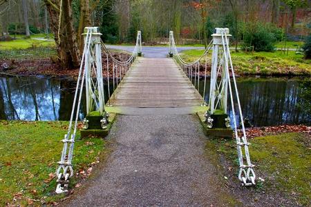 Steel white romantic bridge in citypark Sonsbeekpark Arnhem Netherlands Stock Photo