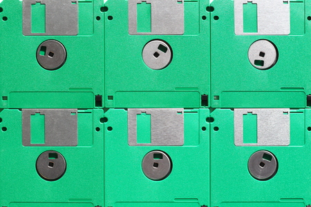 Green floppy diskettes placed next to each other 版權商用圖片