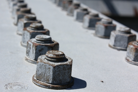 Weathered bolts on a steel beam, part of a bridge in Welland, Ontario, Canada