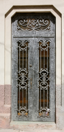A decorative and aged wrought iron entry door