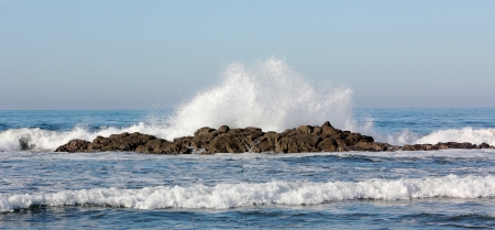 Waves crashing on a rocky reef in the Pacific Ocean, in the early morning