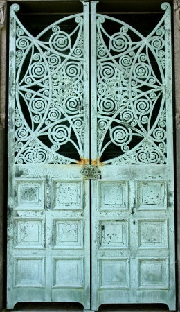 Metal doors aged and weathered to a green patina, on a mausoleum at Graceland Cemetery, Chicago, Illinois, USA Stock Photo