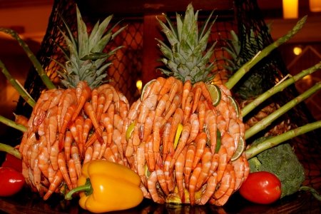 Peel and eat shrimp displayed as a pineapple sculpture on a buffet table