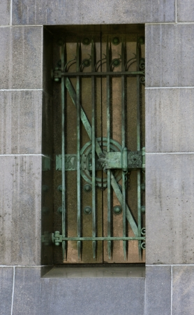 graceland: Decorative metal bars aged and weathered to a green patina, on a mausoleum window at Graceland Cemetery, Chicago, Illinois, USA